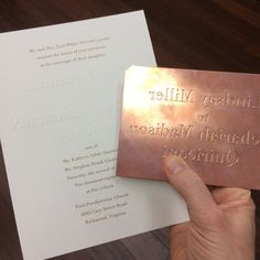 The blind-embossing of the bride & groom's names on these invitations required the creation of a custom copper die.