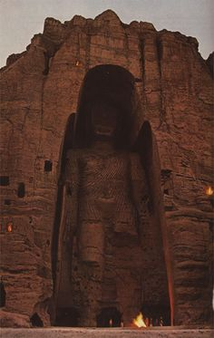 """Lord of the world,"" Buddhists of the Bamiyan Valley called this 175-foot statue of the Perfect One. — National Geographic, 1968. (Destroyed by the Taliban in 2001)."