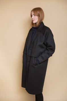 Double layered coat from Reality Studios. A statement piece this coat is comfortable and features side pockets, long sleeves and a two-button front closure. The Roger coat is lined and also available