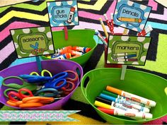 Get different baskets, buckets, or containers and make labels for them. Place the labels on with pegs. Simple!