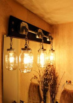 JARS OF LIGHT- Industrial Mason Jar Lighting Sconce Handcrafted with Galvanized Conduit & Stained Decorative Wood Base.. $179.00, via Etsy.