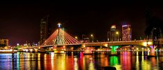 Han Bridge At Night - Hàn River bridge (Vietnamese: cầu Sông Hàn) is a bridge in Da Nang, Vietnam. Da Nang lies on the west side of the Hàn River and the beaches are to the east. In the middle of the night, traffic is stopped from crossing the Song Han Bridge and it swings on its axis to allow shipping traffic to pass along the river. The Song Han Bridge in Danang is a cable-stayed bridge that is lit up brightly at night. The area around the bridge is the location of Da Nang's cultural…