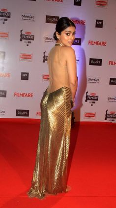 Shriya Saran showing her sexy back on the red carpet at the Filmfare Awards show. #Bollywood #Fashion #Style #Beauty #Hot #Sexy