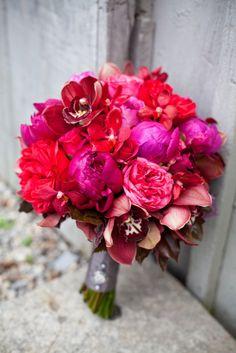 Peony, mokara orchid, cymbidium orchid and rose bouquet.