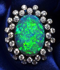 Rare Black Opal Ring.Dream of luxury? Take a look at http://www.designyourownperfume.co.uk to create your own beautoful custom perfume at an affordable price.