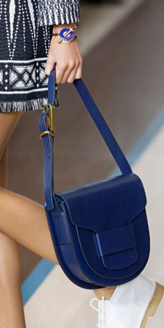 The saddlebag — clean lines with just a touch of brass hardware #toryburch #toryburchspring15  #nyfw