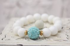 White Shell Stretch Bracelet w Turquoise Carved by LaliJewelryShop https://www.etsy.com/listing/156003018/white-shell-stretch-bracelet-w-turquoise