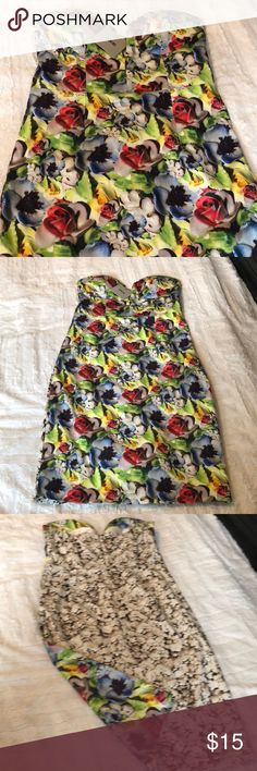 NWT ASOS Dress New with tags. Super cute mid front cut dress. Form fitting with different floral patterns.   I wear a uniform for work so all items being sold are in fantastic condition, and I'm just cleaning out my closet for an upcoming move. ASOS Dresses Strapless