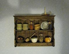 Wall shelf,filled, Tudor or country style, twelfth scale dollhouse miniature
