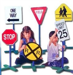 These Drive Time Traffic Signs would be a great tool to use to teach children about traffic safety. Or if you are having a road sign party, bring out the bikes and play away. e.g $59.95 http://www.sensoryedge.com/drtrsibygu.html