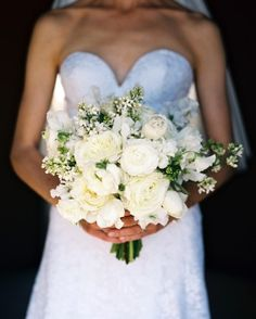 The bride's bouquet included a mixture of white tulips, white lilac, David Austin garden roses, ranunculus, white sweet peas, and fringed tulips.