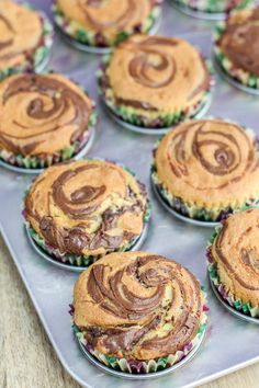 You can obviously pipe some frosting over these Nutella Swirl Cupcakes, but these are already delicious and decadent on their own. Why mess with perfection? Swirl Cupcakes, Caramel Cupcakes, Mini Cakes, Cupcake Cakes, Maya, Kitchenette, Cake Batter, Nutella, Frosting