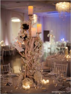 Tall branches centerpiece, with white flowers and candlelight