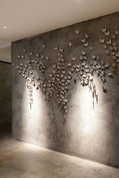 Gallery - Vivarium / HYPOTHESIS + Stu/D/O Architects - The feature wall of restaurant - porcelain butterflies on grey - calmness. Project Description Vivarium is a new restaurant in Bangkok, Thailand, constructed within a decommissioned warehouse owned by Apartment Interior Design, Best Interior Design, Interior Decorating, Interior Walls, Plaster Art, Plaster Walls, Appartement Design, Wall Treatments, Wall Sculptures