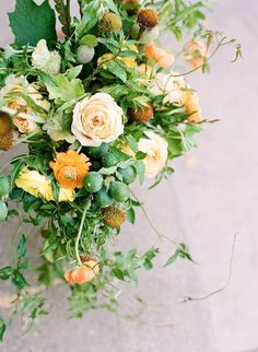 inspiration | yellow and green floral centerpieces | via: once wed