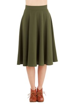 Bugle Joy Skirt in Olive. You hear your friends truck horn toot outside your window - your trumpet call to scoot this A-line skirt out the door and hop in! #green #modcloth