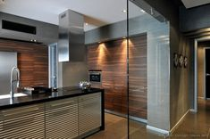 Idea of the Day: Modern Dark Wood Kitchens. Very lovely, dark wood macassar ebony island hood Dark Wood Kitchen Cabinets, Dark Wood Kitchens, Cool Kitchens, Interior Design With Glass, Kitchen Pictures, Kitchen Ideas, Modern Glass, Modern Kitchen Design, Kitchen Styling