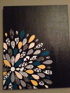 Scrapbook paper petals on canvas