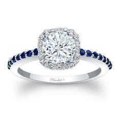 Halo Engagement Ring With Blue Sapphires  - 7838LBSW - Stunning, in vogue, this white gold diamond halo engagement ring will capture the eye of many admirers. Micro pave diamonds encircle the low profile round diamond center and blue sapphires cascade down the dainty shank for a look of sheer elegance.    Also available in 18k and Platinum.