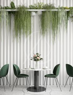 Lush indoor plants bring life to the textured white wall and complement the contemporary dark green chairs, the lounge café design brings together organic shapes and elements with modern and minimal interior forms, effortlessly creating an elegant café interior, by Comelite Architecture, Structure and Interior Design. #loungecafe #cafedesign #whiteinterior #cafeinteriordesign