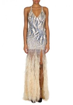 Jovani | 'Nude' Dress | Jovani gown with a v neckline and a sexy slit features intricate sequin and beading detail and a tiered feather skirt
