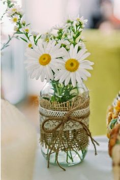 An easy rustic wedding centerpiece idea - lace, burlap, flowers, mason jar.
