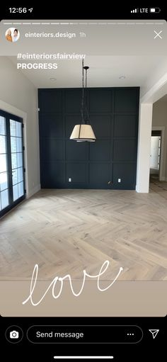 Love this light wood herringbone floor against that stunning black accent wall. posted by einteriors design