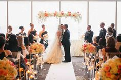 floral on pedestals lining the aisle then placed on guest dinner tables for reception.