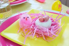 Create cute little bird's nest for your Easter Table with donuts and chocolate candies! Kids and adults alike will love them. Get more Easter Table Setting on a Budget ideas now at fernandmaple.com!
