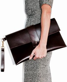 This large/oversized brown leather clutch is the ultimate piece of sophistication. Elegant in its minimalist simplicity yet functional to carry