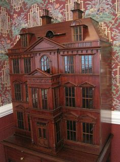 I have this!  It is actually a dry bar cabinet, but I plan to turn it into a dollhouse. Jeanie