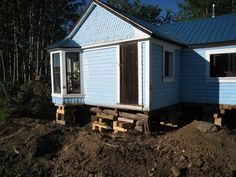 Here is our Little Blue House in Atlin, BC, Canada! We are restoring the Gold Rush house, built circa 1898. See our Victorian home restoration blog at http://littlebluehouse1898.blogspot.ca.