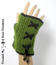 Olive and Black Fingerless Gloves with Crisscross Laces. Created by Ta Ankh of Ioni's Creations. http://www.etsy.com/listing/165862987/olive-green-knit-fingerless-gloves-with?ref=shop_home_active_22