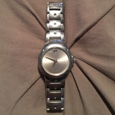 Woman's Movado Stainless Steel Sport Edition Watch Stunning, gently used authentic Woman's Sports Edition Movado Watch. This has been one of my all time favorites. Just time for a change. You can never go wrong with Movado. This watch has a loose pin which is easily fixed. I do not have the original box. Movado Accessories Watches