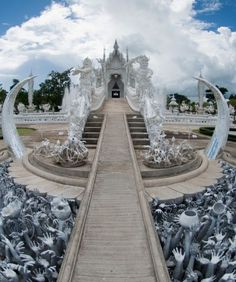 Wat Rong Khun (White Temple), Chiang Rai.  Designed by artist Chalermchai Kositpipat in the late '90s, Wat Rong Khun's white walls look serene from afar, but as you walk the bridge to the entrance you'll be accosted by a sea of ceramic arms reaching for help from deep inside hell. Inside the Buddhist temple, look out for murals of Michael Jackson and Neo from The Matrix. Photo: Pedro Alonso