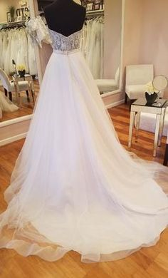 Lillian West 6442 wedding dress currently for sale at 44% off retail.