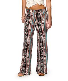 A mixed linear tribal and floral print covers these soft and stretchy pants that feature a relaxed wide cut leg with slight flare for a trendy look.