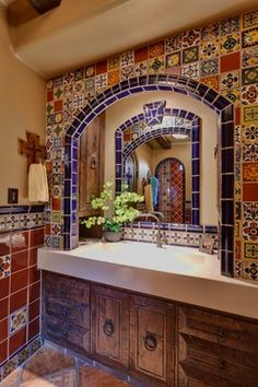 Mexican decor: rustic Mexican talavera delight  Tile around sliding doors?