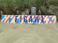 Beach sign Handcrafted Figawi race sign.  Rustic Cape Cod to Nantucket race wood sign.  This would look great in my sailing room!  I love the stripes and flags and it reminds me of Cape Cod on Memorial Day.