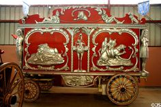 Red & silver circus wagon wild animal carvings at Circus World Museum. Baraboo, WI.