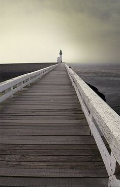 Beautiful inspirational photography - jetty with lighthouse via Malinconialeggera.tumblr.com