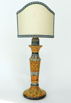 """Candleholder """"Synkeran Line"""". Candleholder in majolica hand-painted. Decoration with bands on 'craquelè' Varnish."""
