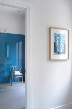 1950's Mallorca home, blue backpainted glass wall in bathroom, Wishbone chair, by Louis Laplace, designer