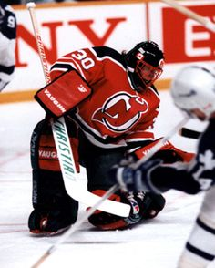 New Jersey Devils goaltending history : Roland Melanson Ice Hockey Teams, Hockey Goalie, Hockey Games, Hockey Players, Nhl, New Jersey Devils, Motorcycle Jacket, History, Sticks