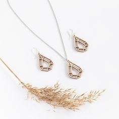 This beautiful ecological design jewelry in extremely light to wear. It is made of light Finnish Birch, which is a pleasant and safe material on the skin. Design by Elina Mäntylä, photo Liivia Pallas. Perfect gift idea for a jewelry lover! We have international shipping. Follow us for jewelry inspiration ❤️ #NordicDesign #FinnishDesignJewelry #GiftIdeas #SustainableFashion #StatementJewelry #WoodenJewelry #MadeInFinland Wooden Earrings, Wooden Jewelry, Ecology Design, Nordic Design, Statement Jewelry, Sustainable Fashion, Birch, Arrow Necklace, Jewelry Design