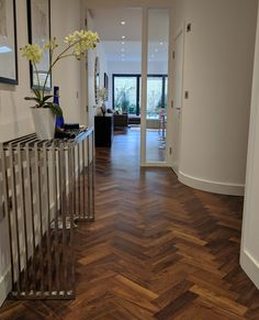 parquet flooring The staggered zig zag pattern of the herringbone design leads the eye from the hall into the adjoining room. Walnut parquet wood floor fitted by Fin Wood. Wood Floor Pattern, Wood Floor Design, Wood Interior Design, Interior Paint, Kitchen Interior, Wood Parquet, Parquet Flooring, Wooden Flooring, Hardwood Floors