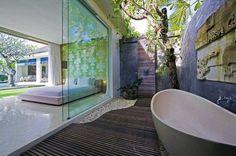 Outdoor Bathtub Ideas bathtub outside of a bedroom with a glasswall