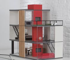 Modern dolls house with sliding panels to create your own design