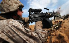 Lance Cpl Lewis fires at enemy targets during a base defense training excercise.
