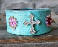 Turquoise Cross Leather Cuff ~ Upcycled from an old leather belt, hand painted and embellished! Very boho chic. See more leather cuffs at www.ever-designs.com (Design © Ever Designs, 2013)